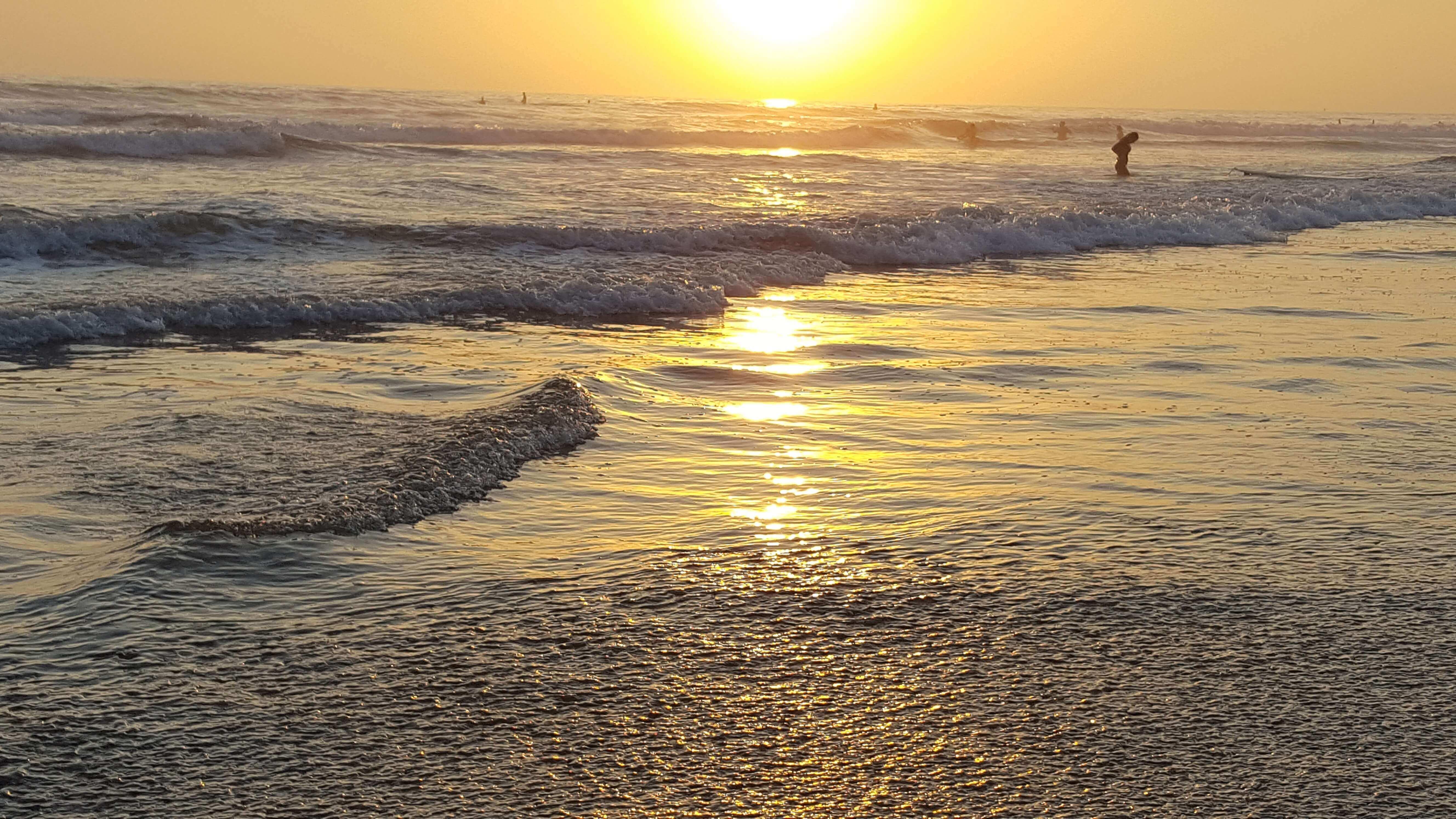 Golden waves of Pacific Ocean near Oceanside Pier