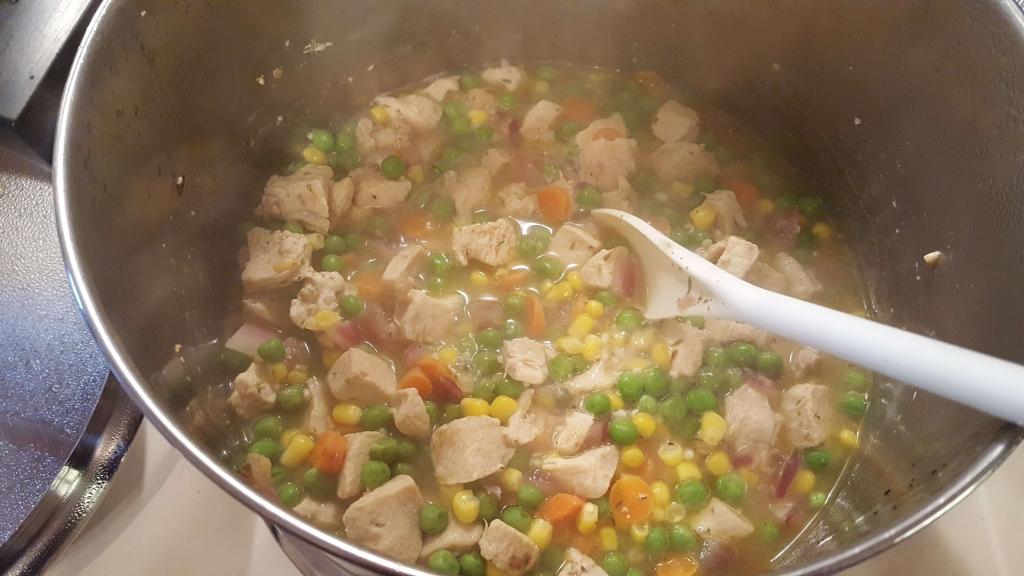 Stirring up chicken pot pie filling