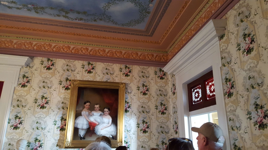 Original red transoms above doors in the Central parlor at Belmont in Nashville, TN